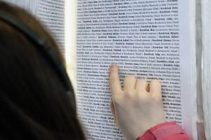Saskia Edwards-Korolczuk searching the book of names